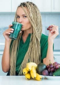 girl drinking early morning meal replacement shake